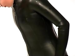 Dressing in beavertail wetsuit & knee boots, dressed in ebony latex catsuit
