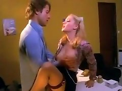 Pretty blond secretary in stockings penetrated on the desk