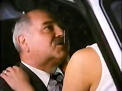 Old Man With Escort In Car