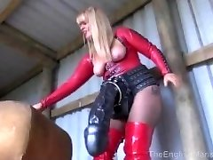 Dom showing off her giant dildos to sissy