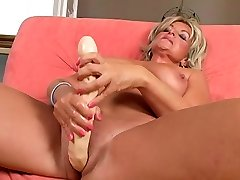 Wild ash-blonde granny is getting her twat poked with big dildo