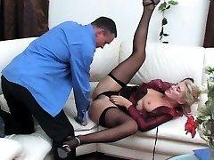 Ebony slut in black fishnet stockings sucks shaft