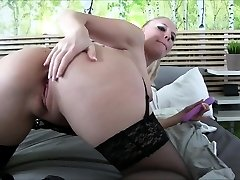 Mature tramp in stocking uses sex toys