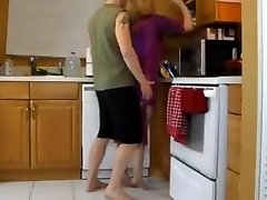Humping mother in the kitchen