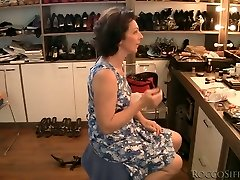 Dark Haired grandma is poked upskirt from behind in POV
