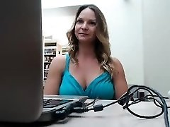 Big breasted blonde mom sensuously gropes herself in a publ