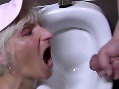 Super-naughty mature twat drinks pee in male s wc