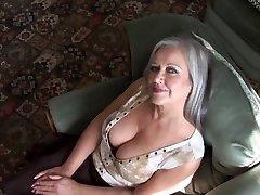 Attractive busty grannie striptease