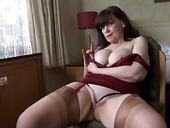 Big tits mature g-string have fun and striptease