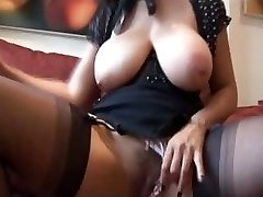 Mature big tits Danica talks dirty as she takes off and teases