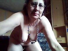 Kinky hairy granny likes urinating in the bucket