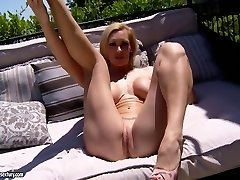 Cocky Tanya Tate jerks while relaxing outside