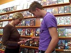 Splendid blonde mature romps him in the video store