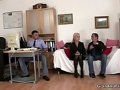 Two folks share old platinum-blonde in the office