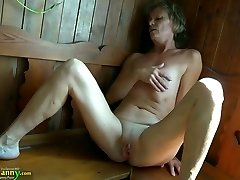 Naughty granny with flat tits fingering her pussy in sauna