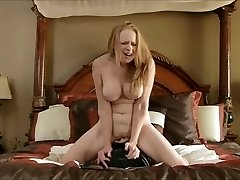 Big-chested mature cums on the sybian