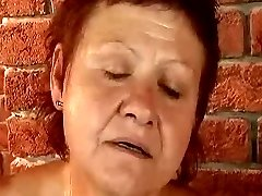 Redhead granny pummeled by the machine
