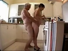 Older duo having fun in the kitchen
