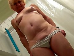 Ugly scaring light-haired oldie takes a shower and teases her mature coochie