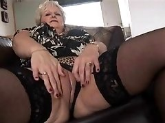 Curvy golden-haired older babe undresses
