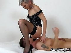 Hot stocking gams mom Beate sitting on a boy