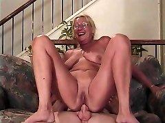 Mature blonde with glasses sucks a schlong