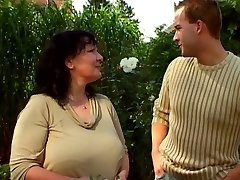 Garden granny and younger stud 03