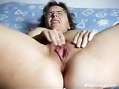 Mature wife frigging herself