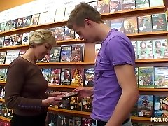 Sexy platinum-blonde mature boinks him in the video store