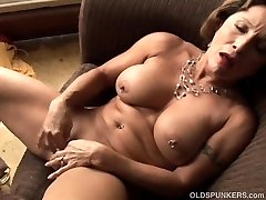 Tastey elderly spunker with a tight bod plays with her wet pussy