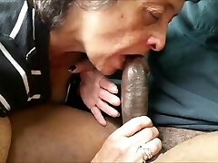 Thirsty grandma eating a big black cock