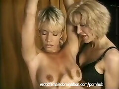 Blonde slave with a scorching body dominated by a kinky milf