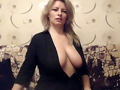 Mature Big-boobed Milf teases on Web web cam