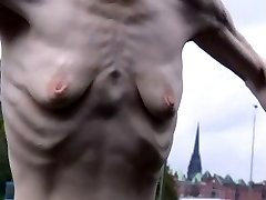a bony mature woman with small empty saggy tits