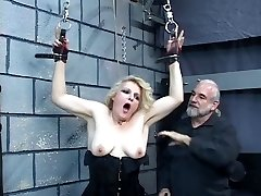 Elder blonde milf gets strapped in for some discipline