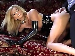Stellar blonde in black latex gets deep fuckin' on a couch