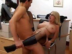 Mature secretary gets cum on her big bra-stuffers