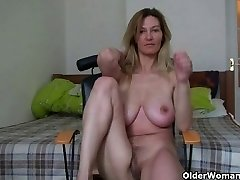 Cougar with big bra-stuffers rubs her mature pussy