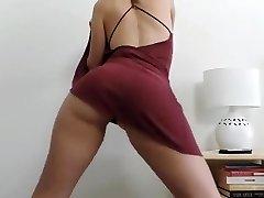 Girl disrobing and dancing