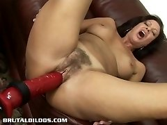 Dark Haired milf is fucked hard by a aggressive dildo machine
