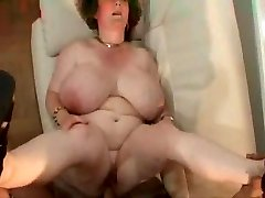 Grannie with big tits.stomach & glasses