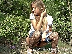 Hairy woman Riana S luvs her walk outside