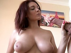 Buxom stunning sandy-haired MILF gives nice titfuck and blowage to fat dick