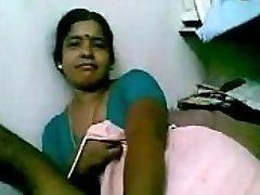 Indian Mature Dark-hued Maid teasing her master