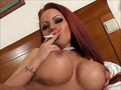 Sexy big tit smoking redhead jacking