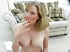 Hot MILF smokes braless for you