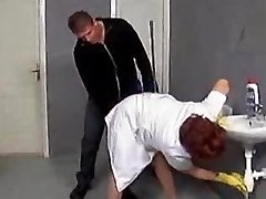 Mature cleaner lured on the rest room floor