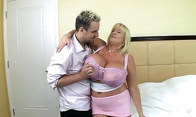 Blonde mature with huge silecone mounds