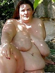 Mature BBW with huge boobs nude outdoors