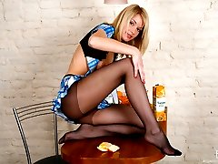 Strikingly beautiful chick with upskirt look teasing with her nyloned feet